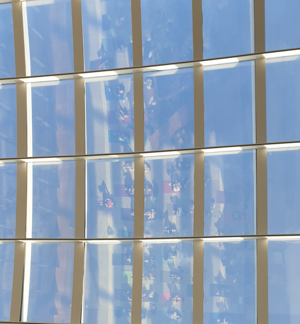 Yoga at sky garden reflection in ceiling